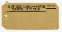 """Image of Label - Two brown manila labels with """"The Canterbury Farmers' Co-Operative Association, Limited, Timaru"""" in black along the top edge and space below."""