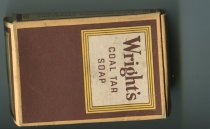 "Image of Soap - Brown cardboard box for soap with white square at top with brown writing ""Wrights coal tar soap"". White square has three yellow borders. On side reads ""Sapo Carbonis Detergens ideal for toilet and nursery"" and other side reads ""Sapo Carbonis Detergens refreshing after work, travel & sport""