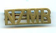 "Image of Badge, Military - Shoulder badge for the New Zealand Mounted Rifles.  Badge is brass with the letters ""NZMR"" in a straight line.  Has brass looped pin behind."