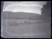 Image of [Piggott cycling at Clayton Station] - Clayton Station Collection