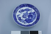 Image of Saucer - Royal Worcester transfer-printed saucer for tea cup 955/37.2 with blue on white Willow pattern.