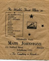 """Image of Bag - Small brown paper bag with """"Obtainable from Matt Johnstone, 133 Stafford Street Timaru. The World's Finest Music - For Everything in Records"""" printed on it"""