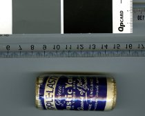 """Image of Sewing Supplies - Packet of shirring elastic unopened. Cardboard cylinder with elastic yarn wound round covered by blue paper label with """"Ripple Lastic Gloveen yarn  Elastic Yarn 25 yards appx. An Oceans of Notions Product Made in England Instructions inside spool.""""  Covered in clear plastic.  Inside is the instruction sheet."""