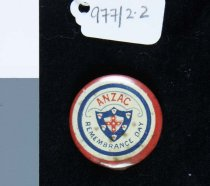 """Image of Medal, Commemorative - Stick Pin, """"Anzac Remembrance Day"""". Small round metal button with rings of red, white and blue with """"Anzac Remembrance Day"""" and shield with red cross in the centre. Metal pin at the back."""