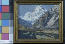 Image of Painting - A small framed oil painting of Mt Cook, New Zealand by Duncan Darroch.  The painting depicts the snowy mountain of Mt Cook in the centre top and other brown rocky faces at the sides. Scrub, trees and river flats are featured in the foreground. The sky is a mid grey blue.  The frame is 2.5cm wide gold - brown painted wood.