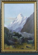 Image of Painting - Oil painting of Mt Cook. Mt Cook is in the centre of picture, viewed through ravine with glacier. Scrub trees depicted lower left hand side and dark mountain range on the right hand side. Some cloud in the sky. Sun blushed sky and ice on mountain.  Signed lower left hand corner J Douglas Perret 1896.  Framed by Grays Studio Dunedin.