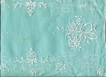 Image of Mat, Table - Green linen table mat with white embroidery.