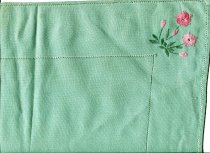 Image of Runner, Table - Green linen table runner with pink embroidery. Matches 2012/107.13  Runner has drawn thread embroidered hemstitching around the outside edge and then again 8cm in from the edge. In each corner is floral motif hand embroidered in two tones of pink thread for the flowers and some leaves and green thread for stems and other leaves.Stitches used are satin, lazy daisy and stem.Two of the motifs feature two flowers and three buds and the other two have two flowers and one bud.