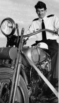 An unnamed Traffic officer posed on an old Harley ...