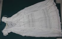 Image of Gown, Baptismal - Infant's white cotton broderie anglais christening gown.  Front: Round neckline edged with white cotton lace and with casing for tape. Centre panel,which widens towards the hem has alternating bands of two types of insertion lace (on the diagonal for top 20cm), pin tucks (4) and frills of broderie anglais. This centre panel is edged with broderie anglais.  Sides and back are the same i.e. Plain bodice with casing at the waist for tape. Back opening placket. Skirt gathered onto waist. Pintucks (3), insertion lace and frill of broderie anglais at the hem.  Sleeves: Short sleeve gathered at neck edge with casing. Sleeve gathered into band with broderie anglais frill. Gusset of different lace under arm.  Construction: Machine sewn. Machine made lace. Mixture of French, flat fell and raw seams.