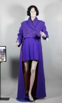 "Image of Coat - Hand woven purple woman's coat by Doris O'Brien which is short at the front and long at the back and called ""Phantom of the Opera"".
