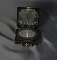 Image of Compass - Compass in black metal case.  Clasp of case is broken.  Has loop to attach to belt or similar.  On base is written Compass Magnetic Marching Mark 1, B 60723, T G CO Ltd""