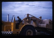 Image of [A 'Carryall' collecting sand for reclamation at Timaru] -
