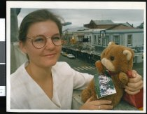 Image of Anna Cunningham with teddy 'Murmurs' - Timaru Herald Photographs, Personalities Collection