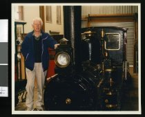 Image of Alf Dowall posed with the D16 locomotive - Timaru Herald Photographs, Personalities Collection