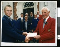 Image of Jack Hart presenting a cheque to Craig Palmer - Timaru Herald Photographs, Personalities Collection
