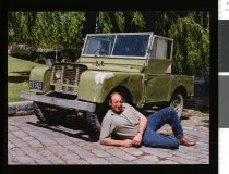 Image of George Hennessy with his old landrover  - Timaru Herald Photographs, Personalities Collection
