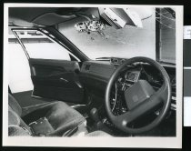 Image of Police officer Roger Herridge's car after being shot at - Timaru Herald Photographs, Personalities Collection