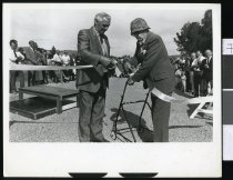 Image of Archie Houstoun (left) cutting a ribbon - Timaru Herald Photographs, Personalities Collection
