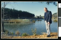 Image of Des Kearns at the Centennial Park lake - Timaru Herald Photographs, Personalities Collection