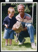 Image of Nicholas Brown and Leo Leonard with an ostrich chick - Timaru Herald Photographs, Personalities Collection