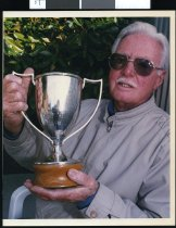 Image of Tom Neilson holding singing cup - Timaru Herald Photographs, Personalities Collection