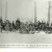 Image of Grand Forks Lumber Company Eating Dinner Outside - Grand Forks Lumber Company, logging camp dinner/lunch at Upper LaSalle, Grand Forks Lumber Company Camp, dinnering out,1909