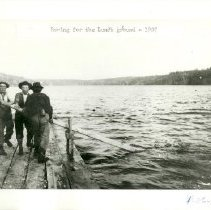 Image of Three Loggers rowing for lunch ground - Three Loggers rowing for lunch ground, Jim Minor in center, 1907.