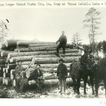 Image of Grand Forks Lumber Company Decking Logs at Upper LaSalle - Decking logs, Grand Forks Lumber Company, logging camp at Upper LaSalle Lake, 1909