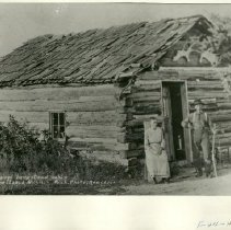 Image of Couple in Front of Original Homestead Cabin - Couple in Front of Original Homestead Cabin, Lake Itasca
