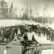 Image of J.A. Irvine's logging camp #8 - J.A. Irvine's logging camp #8, 3 miles northeast of Blackduck, 1904-05. Group of loggers and horses standing in camp.