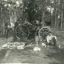 Image of Henry Sand Eating Lunch Near Horse and Wagon