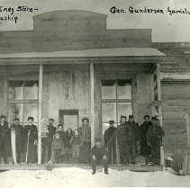 Image of Group in Front of Inez Store, Inez Township - Front of Inez Store, Inez township, 1905. Group of about 20 people in front, George Gunderson family in center.