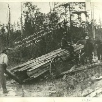 Image of Charles Gunderson Team Working on Wagon of Planks - Charles Gunderson Team, 1902. Ole Olson, Ervin  Jensen, Paul Creek and N. Jones Team working on wagon loaded with planks