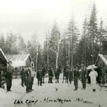 Image of Thorstenson Logging Camp - Group of people and horses in Thorstenson Logging Camp, 1912