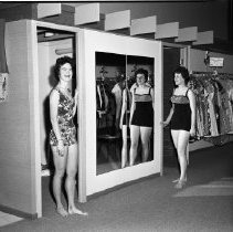 Image of Wilson's Clothing Shop - Wilson's Clothing Store for Women, 207 3rd St., Bemidji. June 1970. Bob Wilson, mgr. Sewell Wilson, owner. Girl in print swimsuit is Margie Wilson. Girl in dark swimsuit is Karen Pollish.