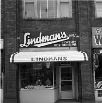 Image of Lindman's Jewelry, Bemidji, 1960 - Lindman's Jewelry, Beltrami Avenue, Bemidji. Larry and Martha Lindman, June 1960. Located in the Elks Building at 320 Beltrami Avenue.