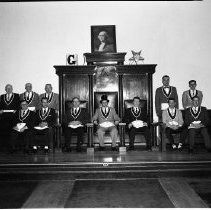 Image of Masonic Temple Officers - Masonic Temple Officers, Bemidji, 1960. Richard Skinner, Grand Master in center chair. Tom Tolman, seated second from the right. May 4, 1960