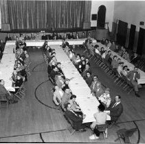 Image of St. Philip School Auditorium - St. Philip School Auditorium, April 3, 1960. Possibly the Confraternity of Christian Doctrine Group. Head table includes Father Joseph Mulvey and layman John Schuiling.