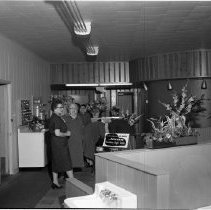 Image of Doran Company Open House - Doran Company Open House, Bemidji February 26, 1960; Ruby Doran with corsage at left of photo.