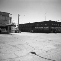 Image of Hartz Store, Glass Block Store, 1958 - Hartz Store and Glass Block Drug at intersection of 5th Street and Beltrami Avenue, Bemidji, about 1958