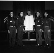 Image of Boy Scouts John Wrolstad Milo Meland and two others 1958 - Boy Scouts, Bemidji May 11, 1958.Left to Right: ?, Don Masterson, Rev. Williams, John Wrolstad, Milo Meland.  Receiving their Pro Deo et Patria medals from Rev. Ray Williams.
