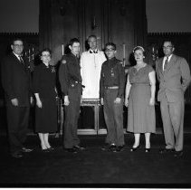 Image of Boy Scouts, Bemidji, Meland Family and other family May 11, 1958 - Boy Scouts, Mr. and Mrs. Masterson, Donald Masterson, Rev, Williams, Milo Meland, Hilma Meland and Joe Meland. The boys are receiving their Pro Deo et Patria medals from Rev. Ray 