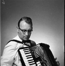 Image of Warren Koxvold, Oct 16, 1959 - Warren Koxvold, popular leader of small dance bands in Bemidji area. Accordionist. Oct 16, 1959