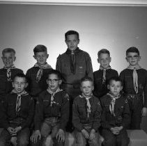 Image of Boy Scouts, Bemidji May 6, 1959 - Boy Scouts, Bemidji May 6, 1959. Front row: Mike Stapleton (front row left), Max Simons, (seated next to Mike Stapleton), Dick Jorstad (second from right), Steve Jewett. Back row: Steve Sawdey (back row left), Jerry Fruetel (back row left), Jack Haugen (center), Tom Keyes (second from right)
