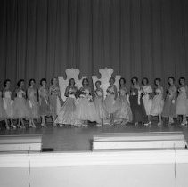 Image of Bemidji Jaycees Carnival 1959 - Bemidji Jaycees Carnival July 1959. Queen Rochelle Hazen in center. To her left, Mary McKee, representing Wilson's. To her right Regina Olson, representing Chester Berg Motors. Joanne Matala is second from the right.