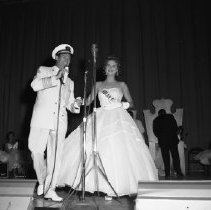 Image of Bemidji Jaycees Carnival 1959 - Bemidji Jaycees Carnival 1959. Presenting the winner, Rochelle Hazen, representing Solar Gas Company. July 1959, Bemidji High School Auditorium.