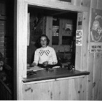 Image of Buena Vista Skiways, north of Bemidji. Set of photos taken Feb 10, 1957 and March 3, 1957 - Donna Dickinson selling ski tickets at Buena Vista Ski Area. Buena Vista Skiways, north of Bemidji. Set of photos taken Feb 10, 1957 and March 3, 1957