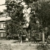 """Image of Dacotah Lodge Lavinia Postcard - Postcard of Dacotah Lodge in Lavinia on Lake Bemidji. Front reads: """"Dacotah Lodge, Lavinia, Lake Bemidji, Bemidji, Minn. Front also has a """"2416"""" on it.  Back is addressed to: """"Miss Elsie Anderson, Mannister, Mich.""""  Postmarked 1926."""
