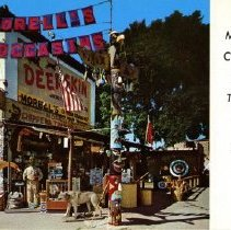 Image of Morrell's Chippewa Trading Post Postcard - Postcard of Morell's Chippewa Indian Trading Post, Bemidji, Minnesota, 1950s.  Back reads:  In a 60-year-old landmark in Northern Minnesota dating back to 1896 and the days of Paul Bunyan. Enjoy the early times atmosphere of Morell's with its large selection of Deerskin moccasins, jackets, gloves and other unusual native gift items. Here you may see Lobo, the Giant Wolf, Killer of Over 200 Deer in this area.